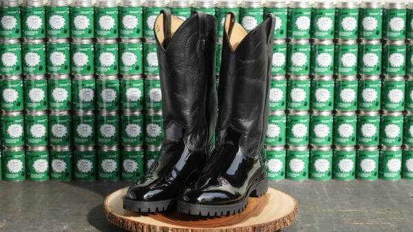 Shiny boots on a wood pedestal